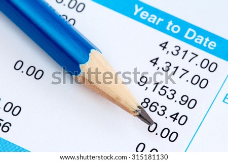 Pencil on the statement of payroll details - stock photo
