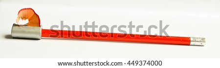 Pencil sharpener and red pencil isolated on white background - stock photo