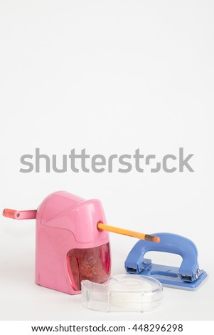 pencil sharpener and Scotch tape and Hole puncher with copy space - stock photo