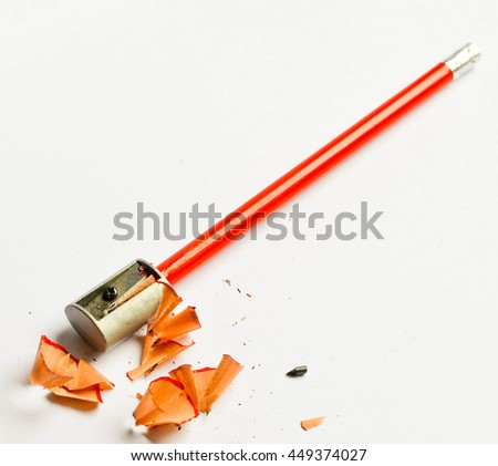 Pencil sharpener and shavings isolated on white background