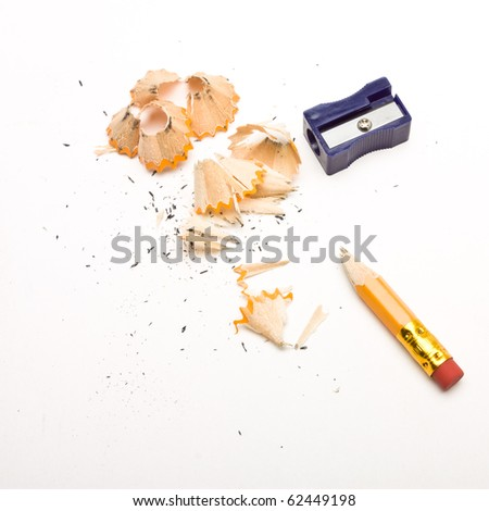 Pencil sharpener and wood shavings from low perspective isolated on white.