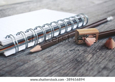 pencil sharpener with blank notepad  - stock photo