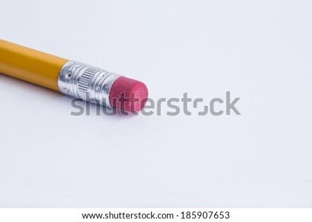Pencil with an eraser on white surface