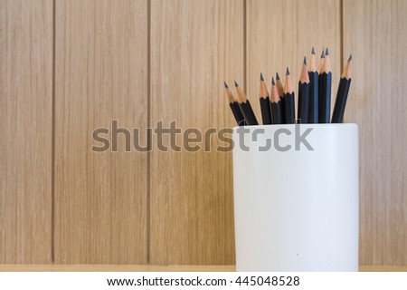 Pencil with box Wood  brown texture background. - stock photo