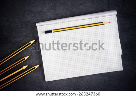 Pencils And Blank Notepad Page as Copy Space for Text Message, top view - stock photo