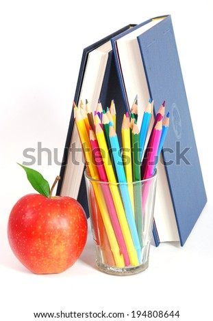 pencils and books on a white background
