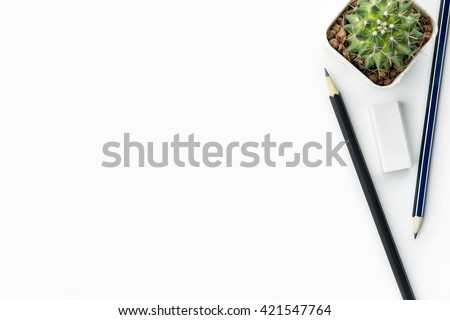 Pencils and eraser are on white desk, top view with copy space. - stock photo