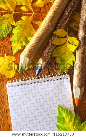 pencils and note on wooden board
