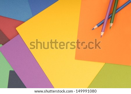 Pencils are on colored paper. - stock photo