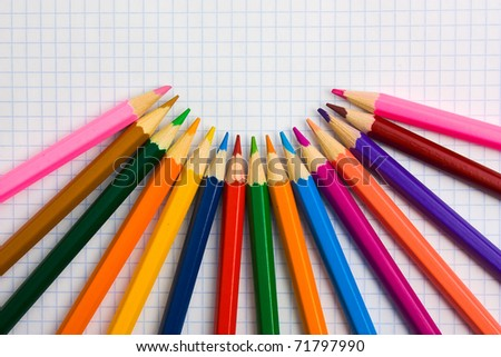 Pencils at the cellular background