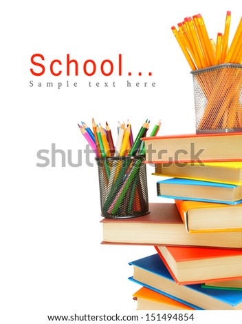 Pencils, felt-tip pens in baskets and books on a white background. - stock photo