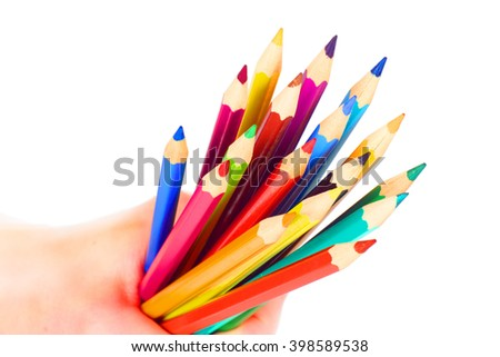 Pencils in hand isolated on white background - stock photo