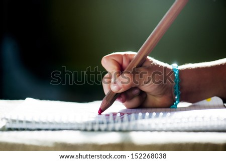 pencils in the hands of the young lady - stock photo