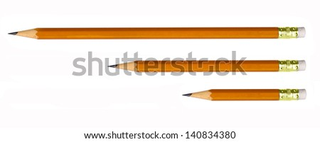 pencils of different lengths isolated on white - stock photo