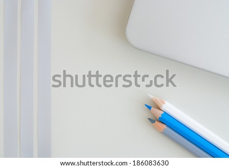 pencils on graphic background  - stock photo