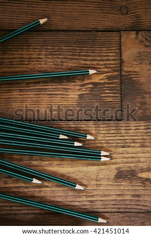 pencils on the wooden background, office theme - stock photo