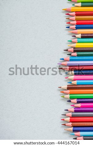pencils spectrum on drawing paper, overhead with copy space. - stock photo