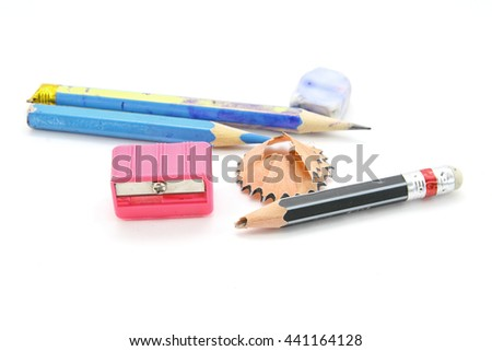 Pencils with sharpener isolated on white background - stock photo