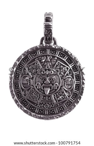 Pendant engraved with the Mayan calendar on a white background - stock photo