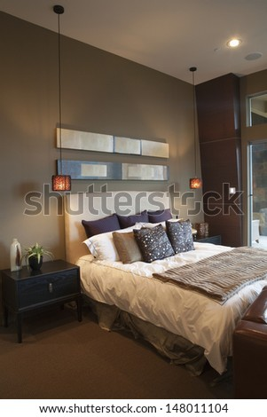 Pendant lights in bedroom with silk furnishing - stock photo