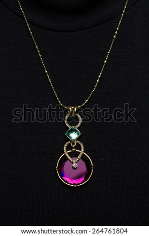 Pendant with sapphire on a black background - stock photo