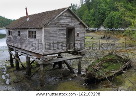 Pender Harbour Net Shed, British Columbia. A rustic net shed and boat wreck in Pender Harbor on the Sunshine Coast. British Columbia, Canada.