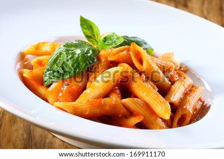 pene pasta in tomato souce - stock photo