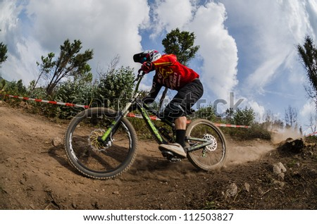 PENELA, PORTUGAL - SEPTEMBER 9: Unidentified rider during the 6th Stage of the Taca de Portugal Downhill Vodafone on september 9, 2012 in Penela, Portugal.