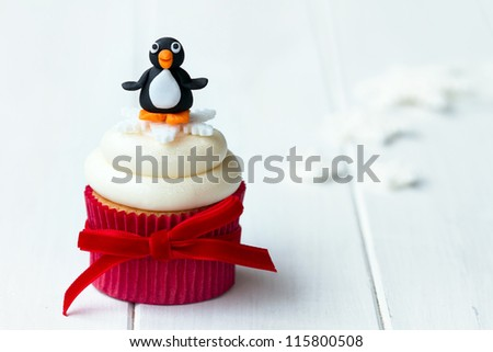 Penguin cupcake - stock photo
