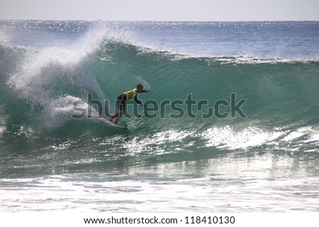 PENICHE, PORTUGAL - OCT 13: CJ Hobgood tube riding a wave in round 1, heat 11 at WCT contest, Rip Curl Pro in Peniche, Portugal on October 13, 2012 - stock photo