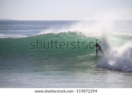 PENICHE, PORTUGAL - OCT 13: Mick Fanning tube riding a wave in round 2, heat 1 at WCT contest, Rip Curl Pro in Peniche, Portugal on October 13, 2012 - stock photo