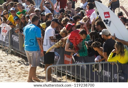 PENICHE, PORTUGAL - OCTOBER 13 : Kelly Slater (USA) in Rip Curl Pro Peniche 2012 giving autographs October 13, 2012 in Peniche, Portugal - stock photo