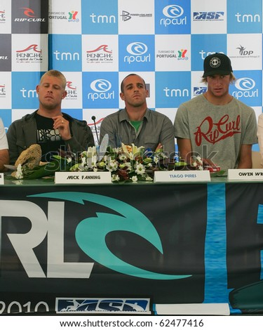 PENICHE, PORTUGAL - OCTOBER 06 : Mick Fanning, Tiago Pires, Owen Wright in Press Conference of Rip Curl Pro 2010 October 6, 2010 in Peniche, Portugal - stock photo