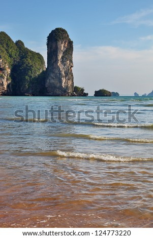Peninsula Krabi coast in Thailand after the big flooding. Picturesque rocks on a beach - stock photo