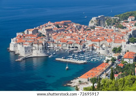 peninsula of walled Dubrovnik old town with harbor, Croatia - stock photo