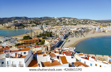 Peniscola, Spain - March 5, 2016: Two beaches in Peniscola, Castellon, Spain, View of this the Castle - stock photo