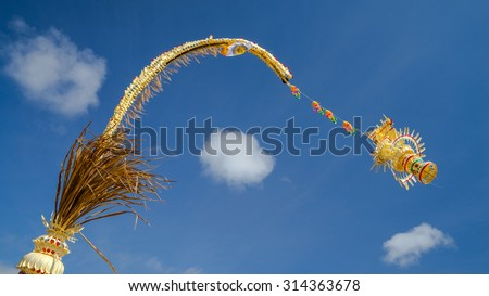 Penjor assembled from various natural products, normally made from coconut leaf is offering from Balinese people in Indonesia.  - stock photo
