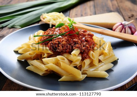 Penne a bolognese - stock photo