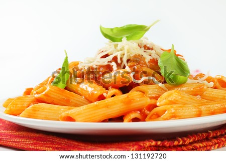 Penne bolognese on a plate - stock photo