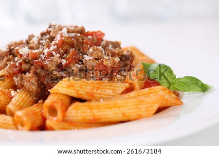 Penne Bolognese or Bolognaise sauce noodles pasta meal on a plate - stock photo