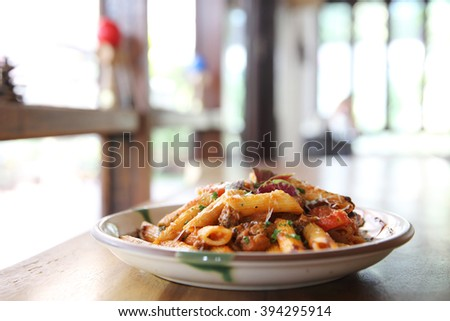 Penne pasta in tomato sauce with meatballs - stock photo