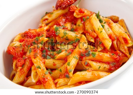 Penne pasta with chili sauce arrabiata - stock photo