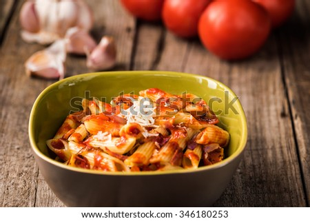 Penne Pasta with Chorizo Creamy Tomato Sauce on Rustic Table Top