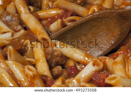 Penne pasta with tomato