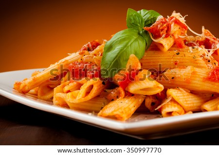 Penne, tomato sauce and vegetables  - stock photo