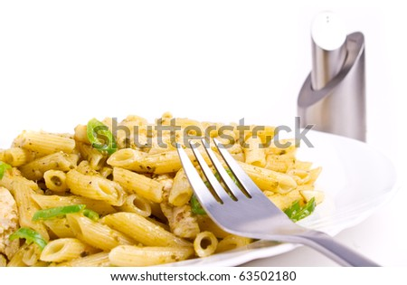 Penne with basil, olive oil and pine dressing (shallow DOF) - stock photo