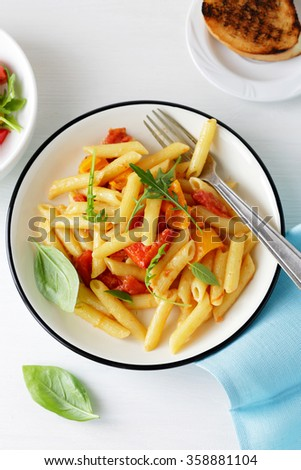 penne with cheese and tomato, food top view - stock photo