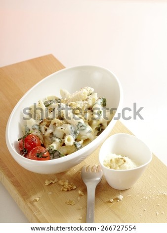 Penne with Gorgonzola and Baby Spinach - stock photo