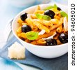 Penne with grana padano cheese and olives - stock photo