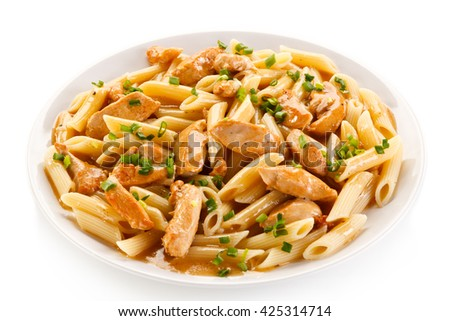 Penne with meat, sauce and vegetables  - stock photo